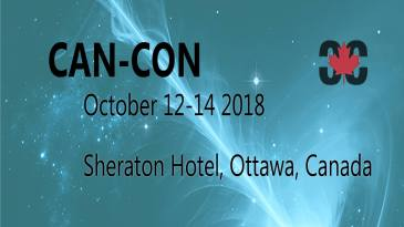 ID: Blue space background with streaks of light and stars. Text reads: Can-Con, October 12-14 2018, Sheraton Hotel, Ottawa, Canada.