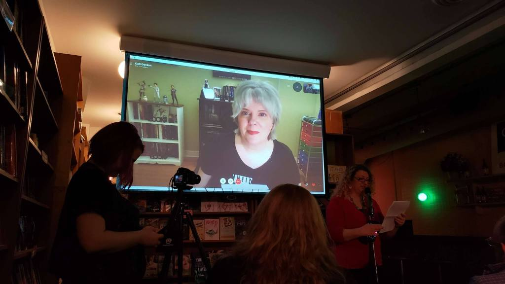 Me on a large screen at Glad Day Bookshop, about to read remotely to a live audience!