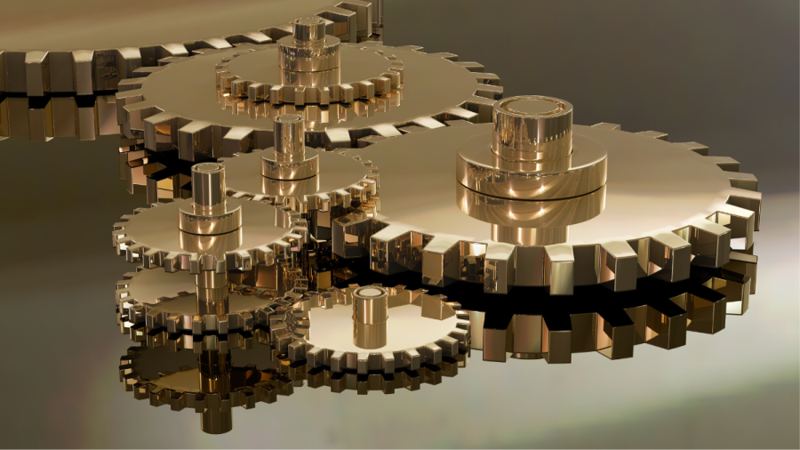 Shiny coppery gears on a reflective surface