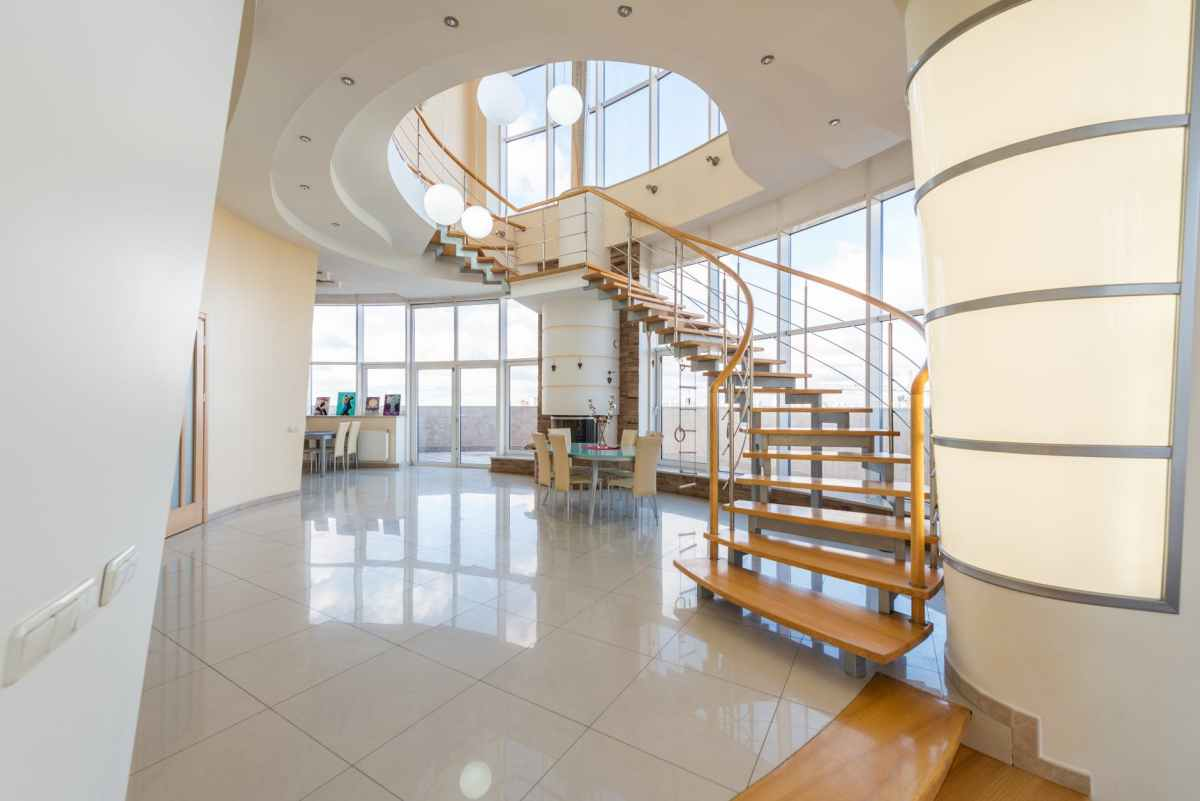 ID: interior of modern flat with winding staircase and a wall of windows