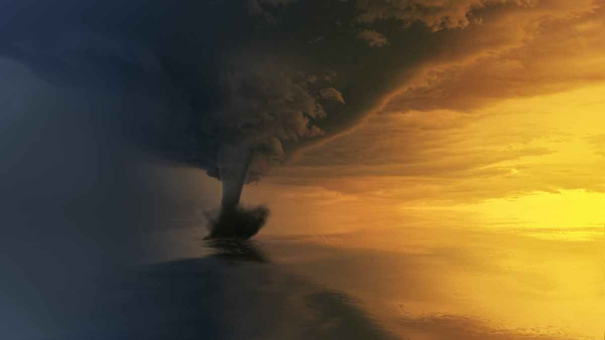 ID: tornado on body of water during golden hour