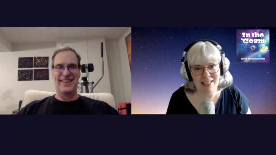 ID: Zoom snapshot of Canadian author Bruce D. Gordon (left), a white man with sandy brown hair and glasses, smiling, wearing a black shirt. He's sitting in a grey room with an elliptical trainer behind him and black abstract paintings. Cait Gordon on the right, against a spacey backdrop with the In the 'Cosm logo.